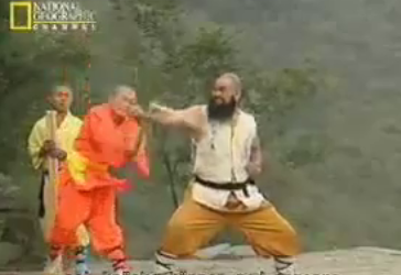 Shaolin Monk Breaks Staff with Arm